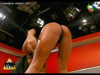 Bruentte in thong bends over to show her pussy