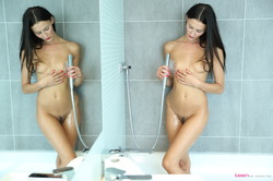 Kira – Strips Out Of Her Tight Bodysuit For A Wet Shower